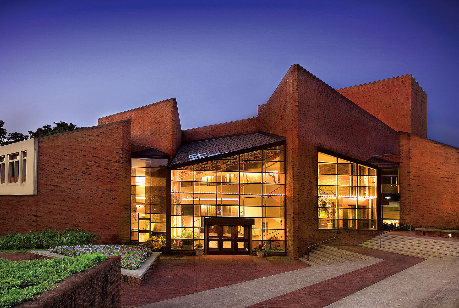 Williams Center for the Arts facade, lit from within at dusk